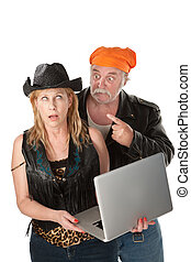 Woman ambarrased by the contents of her laptop - Couple...