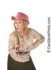 Cowgirl on white background with a recently used pistol -...