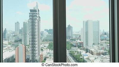 Woman taking bath and relaxing - Window with city view and...