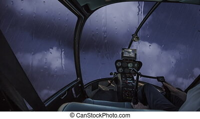 Helicopter in the storm - Helicopter cockpit flying in a...