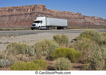 Semi driving dry Utah - Moab area.