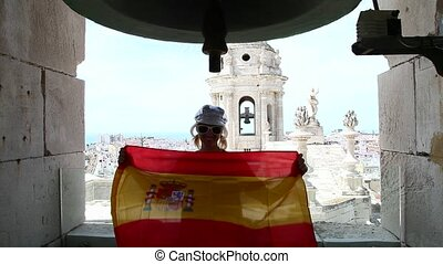 Cadiz town Spain flag - Spanish tourist waving Spain flag on...