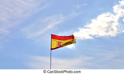 Spanish flag in the sky in with clouds and birds flying. Sky...