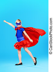 superhero girl - Little girl playing in superhero. Studio...
