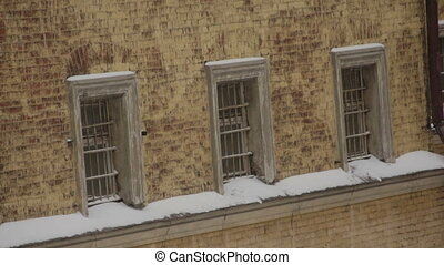 Fragment of old prison building in winter - Three windows of...