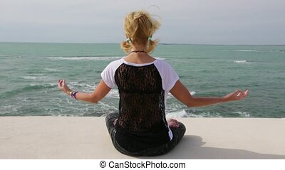 the Yoga meditation - meditation in lotus pose in front of...