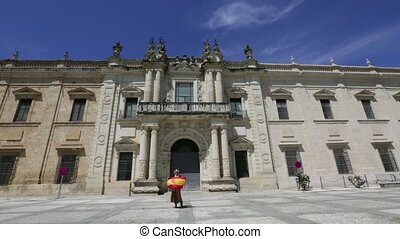 University of Seville - Tourist woman waving spanish flag at...
