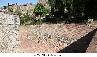 Alcazaba of Malaga - photographer walking at Alcazaba in...