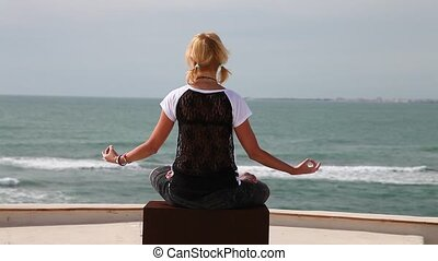 the yoga by the sea - Yoga by the sea with blonde woman in...