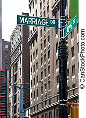 Marriage Love Street Signs - A sign post at the intersection...