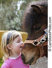 little blond girl loves her donkey funny portrait - little...