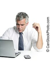 businessman senior gray hair working laptop computer white...
