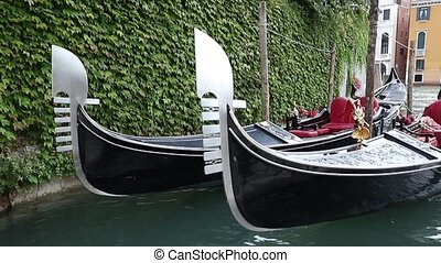Two gondolas are bobbing on the waves - Closeup view of two...