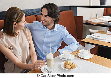 Man and woman having lunch at cafe - Lost in moment...