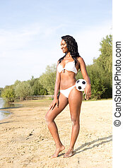 bikini woman - Young woman posing with her ball in her...