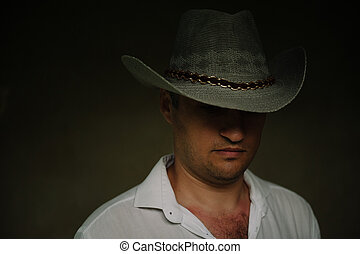 mysterious man in a cowboy hat