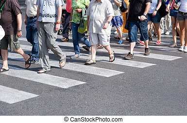 Crosswalk - People crowd crossing the street in a city