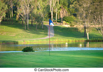 Golf Green - A colourful lush green on a golf course with...