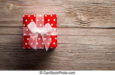 red gift on a wooden background