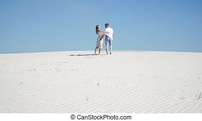 Beautiful loving couple in the desert