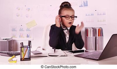 Little business girl working - Little beautiful office girl...