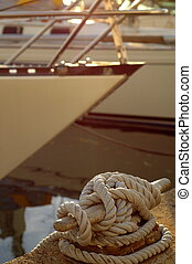 Detail of a Luxury Yacht and Mooring Rope in a Marina at...