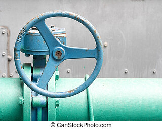 Blue old valve and old green pipe. Industrial water valve.