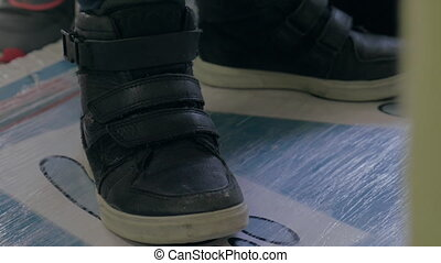 Close up view of boy's feet in black sneakers - Close up...