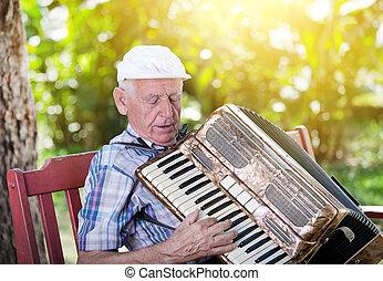 Old man playing accordion - Old man enjoying playing...