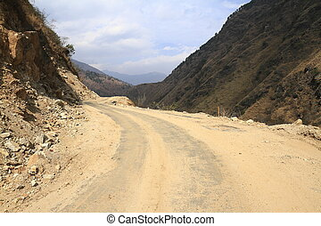 Road in Bhutan - Road in Himalaya mountains of central...
