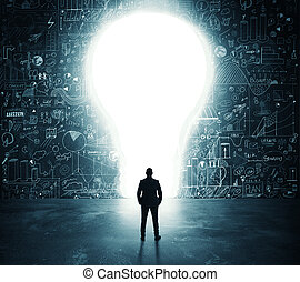 Lightbulb door - Businessman looks at a big hole in the...