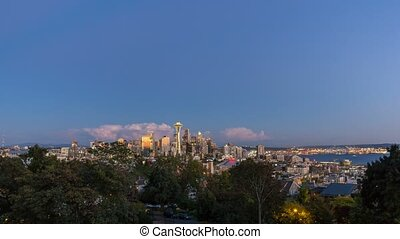 Time lapse over Seattle Wa at sunset into blue hour 4k -...