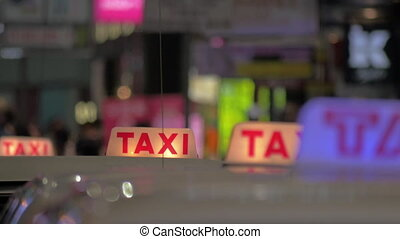 Row of taxi cars in night street - Taxi cars driving slow in...