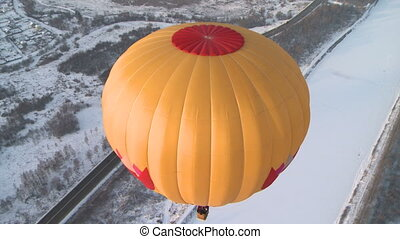 Flying balloons in winter. - Two bright flying balloons over...