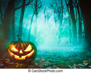 Halloween pumpkin in forest - Halloween background. Spooky...