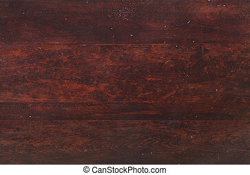 Wood of an old tabletop viewed from above - Reddish wood of...