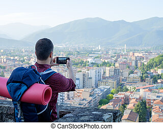Tourist taking picture of european city landscape