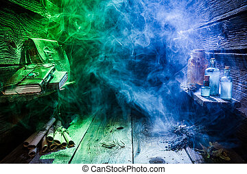 Magical witch hut with blue, green light and copy space for...