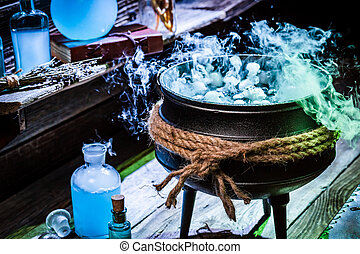 Full of magic mixture witch pot with blue smoke for...