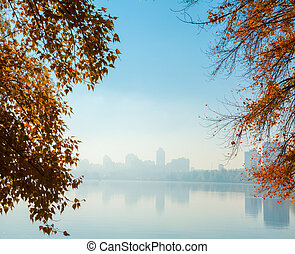 Autumn view of the city - Delicious autumn park overlooking...