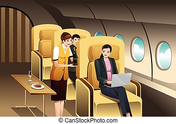 First Class Passengers Being Served by the Flight Attendant