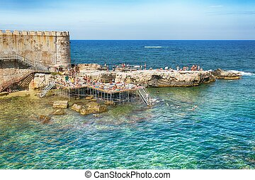 Coast of Ortigia island at city of Syracuse, Sicily, Italy
