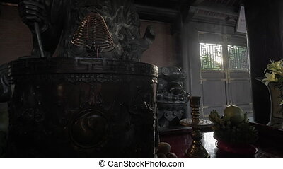 Burning incense and warrior statue in Bai Dinh Temple,...