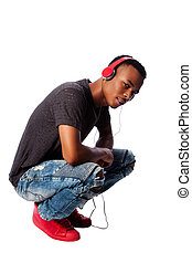 Handsome teenager listening to music