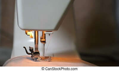 footage of woman sews on the sewing machine 4K video