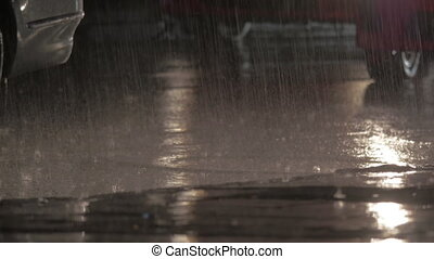 Cars driving under the rain at night - Wet weather in the...