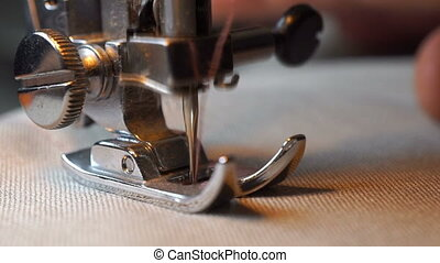 footage of woman sews on the sewing machine. hd