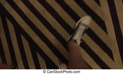 Man feet walking in hotel hallway - Steadicam shot of male...
