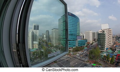 Timelapse of car traffic on city streets. Window view to...