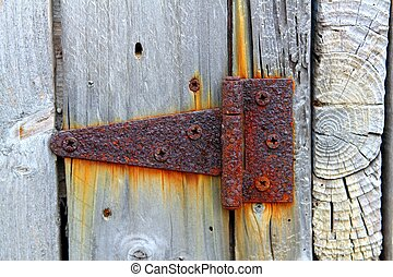 rusty aged iron hinge weathered gray wood door orange rusted